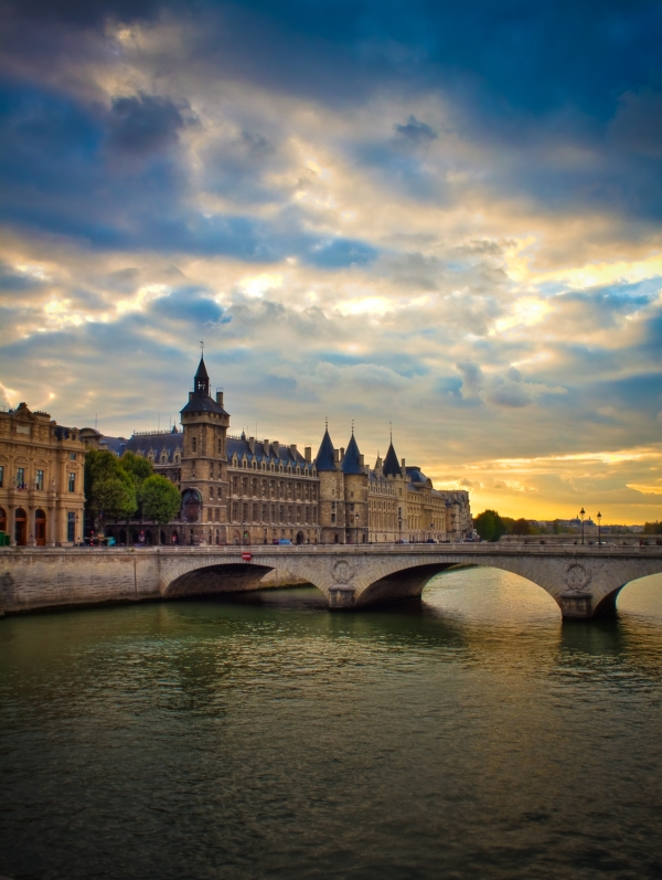 La Seine, Pont Notre Dame and La Conciergerie taken on amazing sunset in blue and yellow