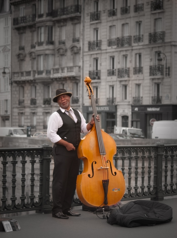 Jazz Bassist by Notre Dame in Paris