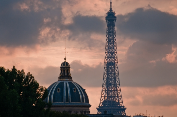 Eiffel Tower and Academie Nationale against an orange sky
