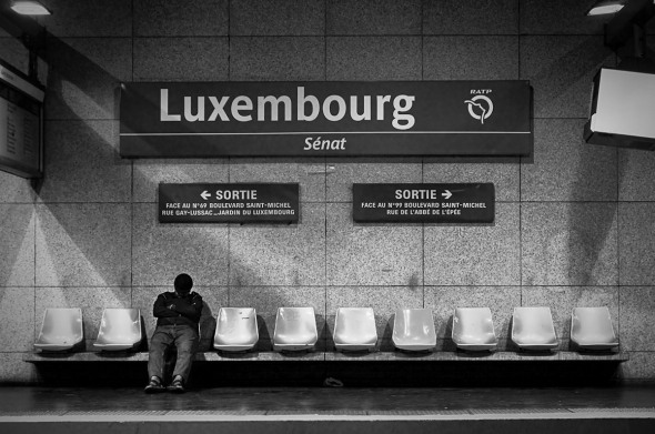 Street photo in Paris metro - fast asleep