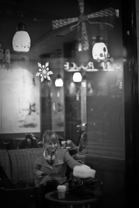 black and white photo, Cathy Kubillus sitting at starbucks